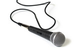 A microphone with a cord, isolated on a white background