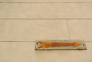 Rusty vintage old arrow sign with copy space