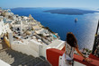 Beautiful woman on Santorini, Thira town