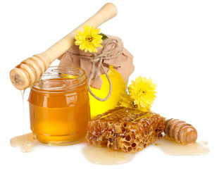 two jars of honey, honeycombs and wooden drizzler isolated