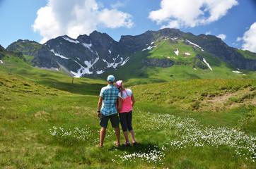 Travelers in an Alpine meadow. Melchsee-Frutt, Switzerland
