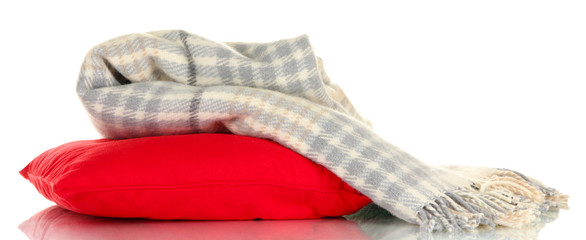 Woolen checkered plaid and pillow, isolated on white