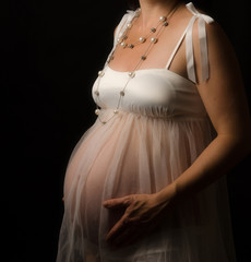 Pregnand Woman on Black