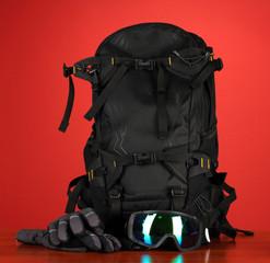 Winter sport glasses, helmet and gloves, backpack,