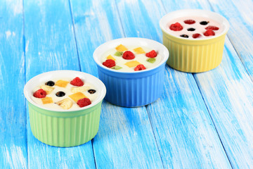Delicious yogurt with fruit on table close-up