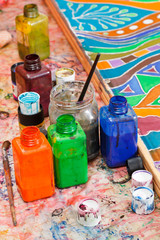 paintbrushes, bottles with color pigments
