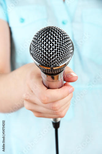Female with microphone close-up background
