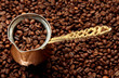 Metal turk on coffee beans background