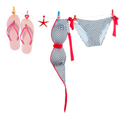 Women's swimsuit and flip-flops hanging
