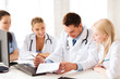 young team or group of doctors on meeting