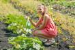 Cute girl watering plants in a garden