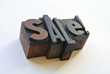 Woodtype letters promoting a sale