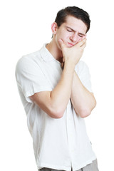 Young men in tooth pain isolated over white background