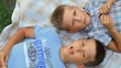 two boys aged 5-7 years lie on your back and look at the sky