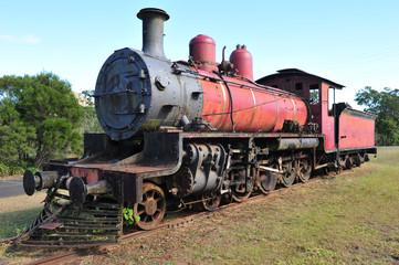old steam locomotive train wreck rusting on tracks, australia