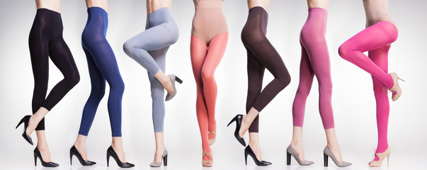 collection of colorful tights and stockings on sexy woman legs