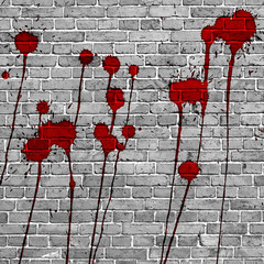 Red Paint Splashes on brick wall background