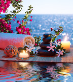 Fototapety Candles - black stones and tiare - Bougainvillea on water