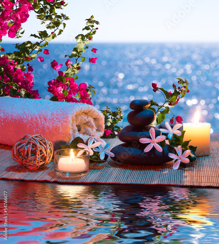 Candles - black stones and tiare - Bougainvillea on water
