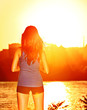 Woman enjoying sunset sunshine after running
