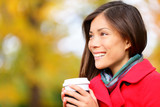 Young woman drinking coffee in Autumn / fall