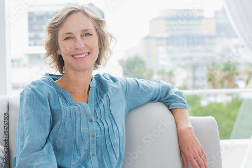 Happy woman relaxing on her couch