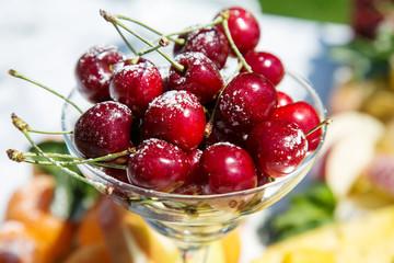 Fresh sweet cherry with sugar powder