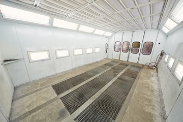 Empty paint-spraying booth for car painting, view from corner