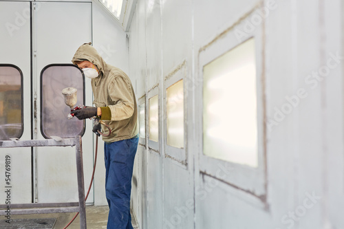 Man wearing protective clothes and respirator works