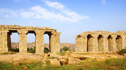 Landscape with ruins of ancient bridge. Hampi, India.