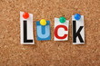 The word Luck on a Cork Notice Board