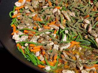 Provencal spices for vegetables and chicken in a big pan