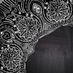Chalk floral corner on chalkboard blackboard. Ornamental round l