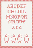 Red knitted alphabet with penguin