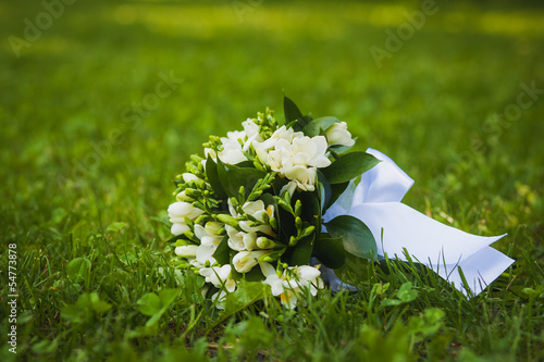 white wedding flowers on the green grass