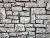 Old gray stone wall background texture