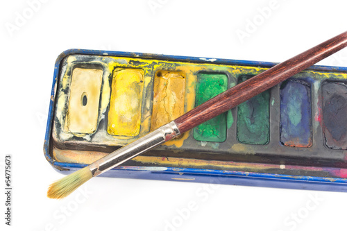 Closeup of Watercolor paints and paintbrush on white