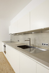 a modern kitchenette oblique angle