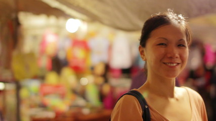 Chinese Young Woman Shopping at asian night market