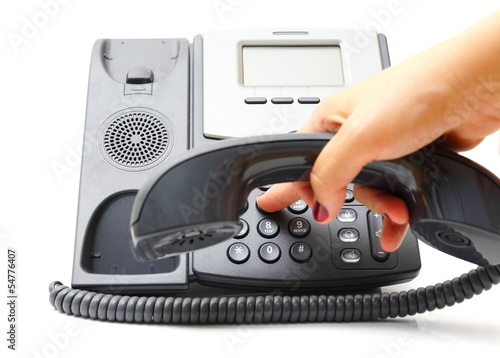 woman hand is dialing a phone number