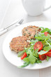 Tomato and arugula salad with fish patties