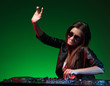 Female DJ. Beautiful young female DJ in sunglasses spinning on t