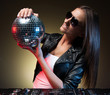 Women with disco ball. Beautiful young women holding disco ball