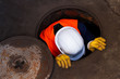 Leinwanddruck Bild - Worker Going Down The Manhole
