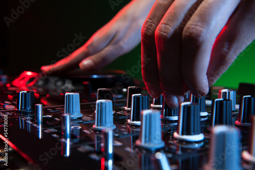 DJ at work. Close-up of DJ hands making music