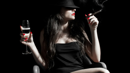 young woman with black hat, cigarillo and red nails