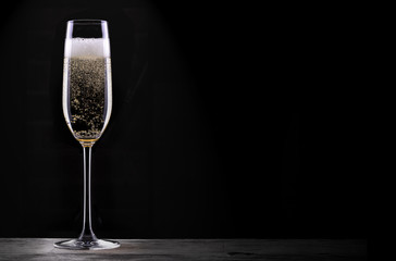 glass of champagne isolated on black background