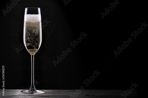 Leinwandbild Motiv glass of champagne isolated on black background