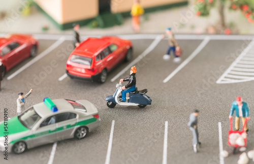 Busy urban life with miniature people and automobiles