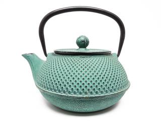 Grüne Teekanne aus Gußeisen